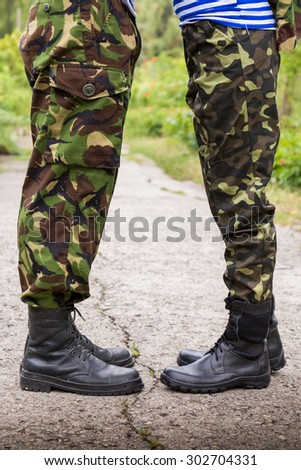 man woman couple feet in military boots