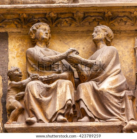 Man Woman Devil Statues Exterior Saint Severin Church Paris France.  Saint Severin one of oldest churches Paris located in the Latin Quarter.  Built in the 1500s - stock photo
