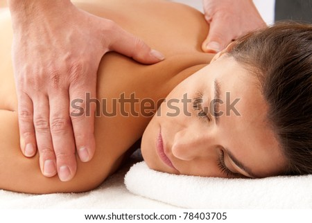 Man woman massage relax treatment close-up  portrait from male hands - stock photo