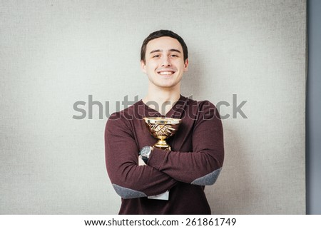 man won the cup and keep it in the hands - stock photo