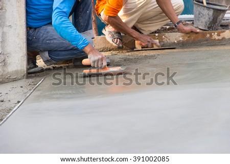 Man work Floor plaster cement - stock photo
