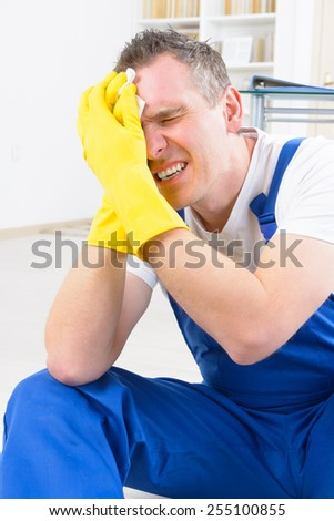 Man worker with head injury, concept of accident at work - stock photo