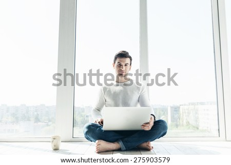 man working at a laptop - stock photo