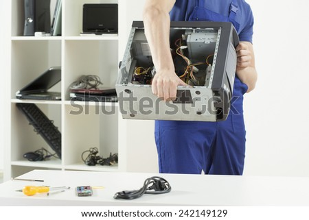 Man working at computer service - stock photo