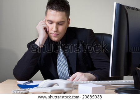 man working at his office - stock photo
