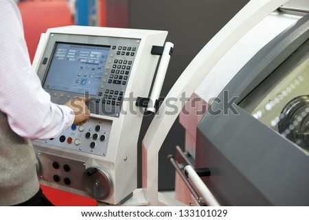 Man working at programmable machine - stock photo