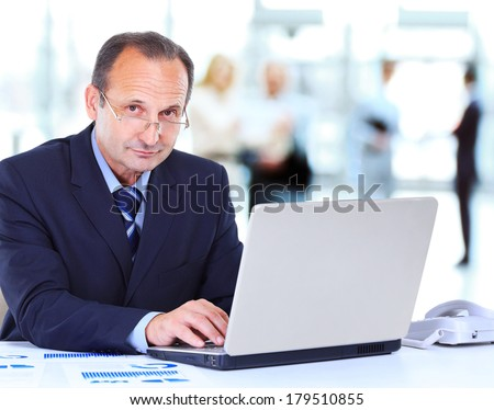Man working at the office on laptop - stock photo