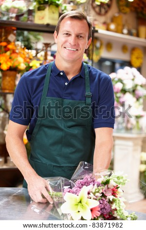 Man working in florist - stock photo