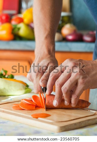Man working in kitchen - stock photo