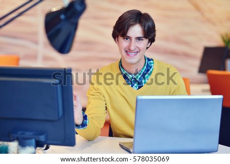 Man working in office in front on notebook