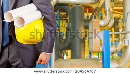 Man working in oil or gas refinery.  - stock photo