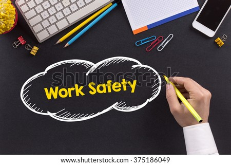 Man working on desk and writing Work Safety - stock photo