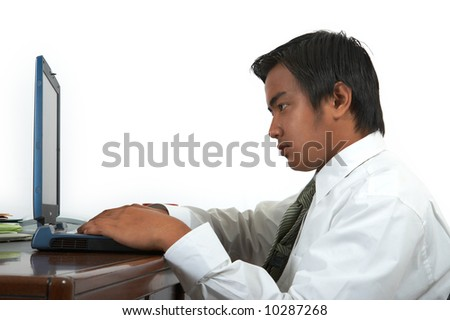 man working on his laptop over a white background - stock photo