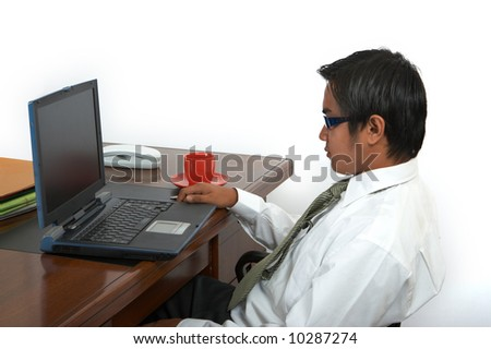 man working on his laptop over a white background