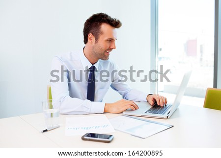 Man working on laptop in the office - stock photo