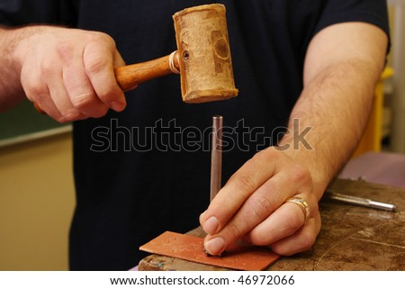 Man working on leather - stock photo