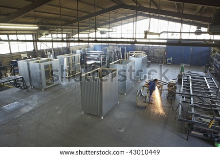 man working on steel construction at industrial workshop