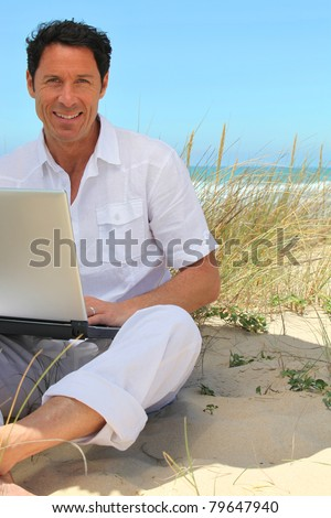 Man working on the beach. - stock photo