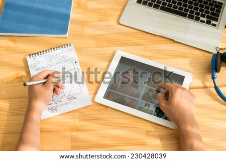 Man working on website design - stock photo