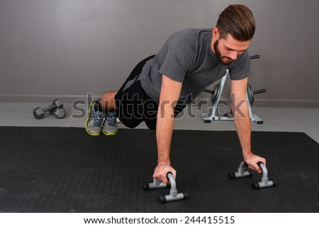 Man working out while at the gym