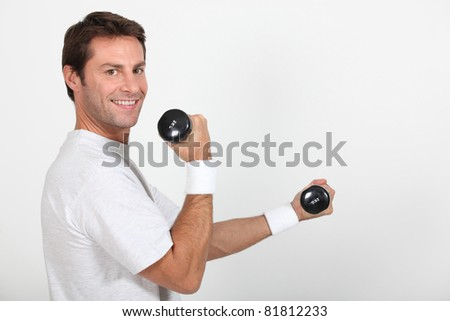 Man working out with hand weights - stock photo