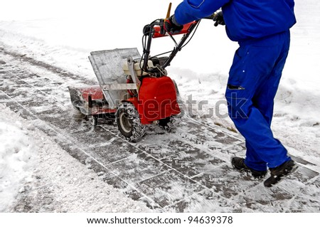 Man working with a snow blowing machine v - stock photo