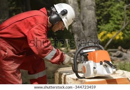 Man Working With Chainsaw - stock photo