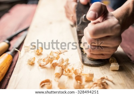 Man working with hand jack plane, close up photo - stock photo