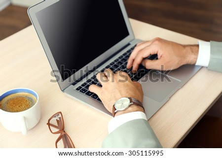 Man working with laptop in office - stock photo