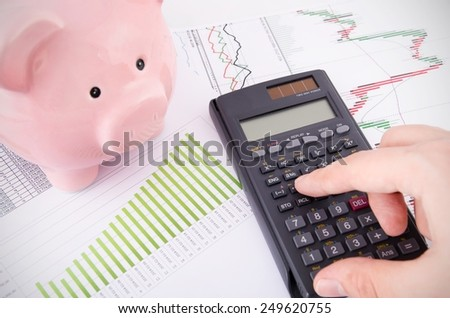 Man working with reports. Saving money business concept