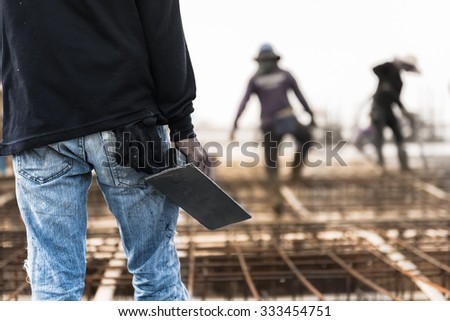 man working with the plasterer tools prepared to plastering concrete - stock photo