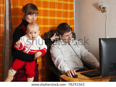 Man works at home. Incomprehension  between man and his family
