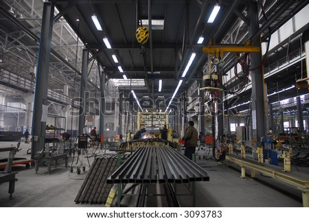 Man works on the factory - stock photo