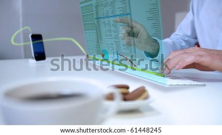 man works with futuristic laptop - stock photo
