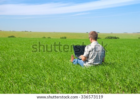 Man works with the laptop outdoors