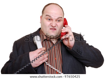 man wrapped in telephone receivers - stock photo