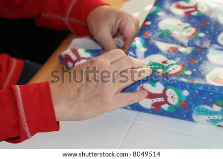 man wrapping holiday present