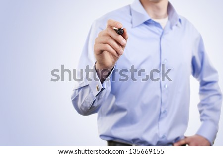 man writes a marker on the board - stock photo