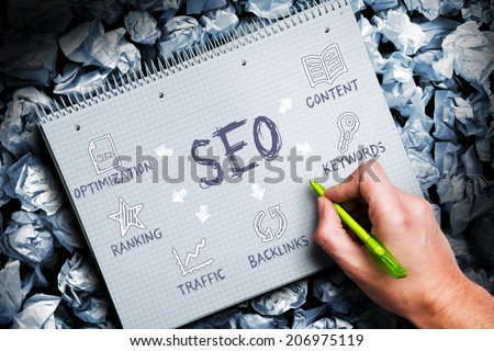 man writing a concept for search engine optimization - stock photo