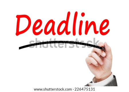 Man writing Deadline Concept with red marker isolated on white background - stock photo