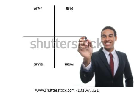 Man writing diagram: Winter, Spring, Summer, Autumn - stock photo