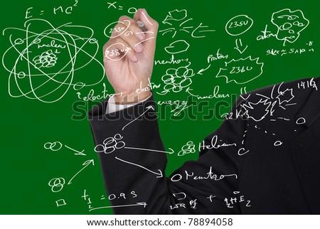 Man writing formula on the glass screen - stock photo