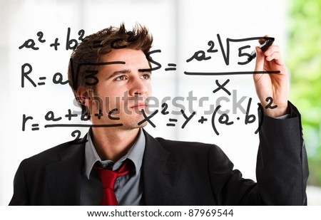 Man writing math formulas on the screen - stock photo
