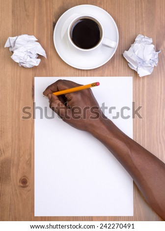 Man writing on a blank piece of paper - stock photo