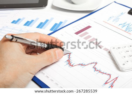 Man writing on a business document - stock photo