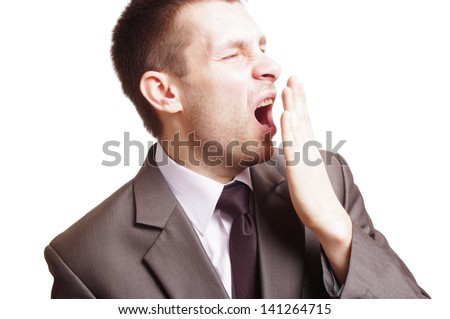 man yawning isolated on white background - stock photo