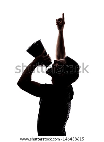 Man yelling in a megaphone in silhouette isolated over white background  - stock photo