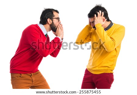 man yelling to his brother - stock photo