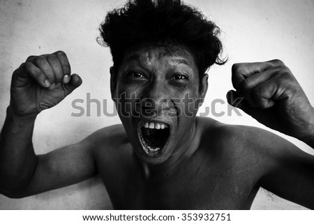 Man yelling with a violent face,Man angry on dramatic black and white image - stock photo