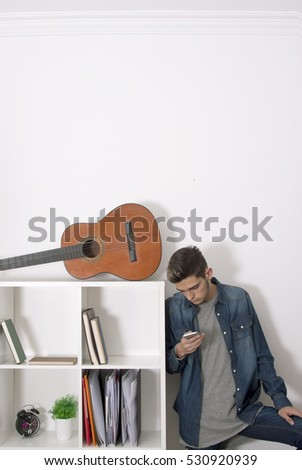 man young teen with the telephone phone in the apartment